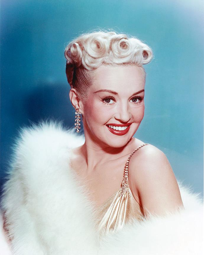 ***Sagittarius (November 22 - December 21): Betty Grable***<br><br>  Bubbly, bright and famous for her comedic timing, Grable was a triple-threat in every sense of the word. An actress, dancer and singer, the *How To Marry A Millionaire* star's positive and jovial onscreen personality was every bit the sunny Sagittarius.