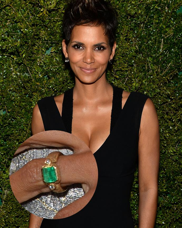 ***Halle Berry***<br><Br> Set on a rustic gold band, Halle Berry's square diamond sits next to two round-cut diamonds.