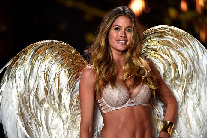 Model Doutzen Kroes walking at the Victoria's Secret Fashion Show in 2014.