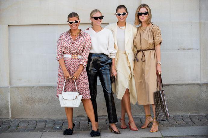 Fashion week attendees coordinate in tonal ensembles.