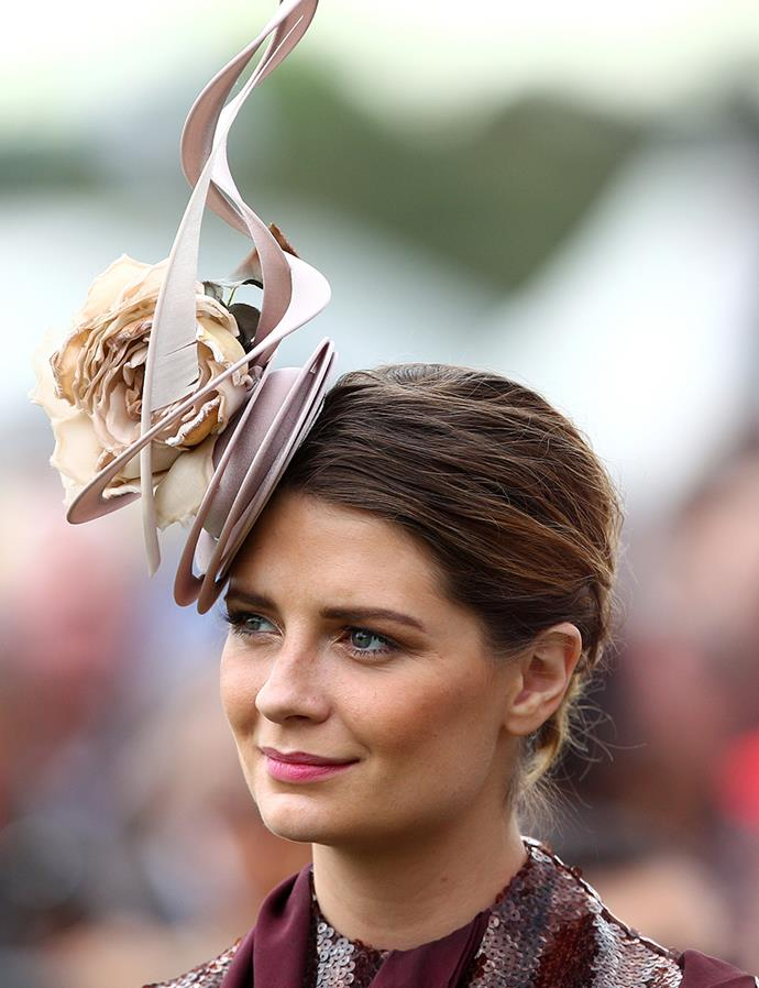 **Mischa Barton at Melbourne Cup Day, 2012** <br><br> When in doubt, a chic chignon will signal poise, especially when paired with a feminine headpiece and pretty pink lip.