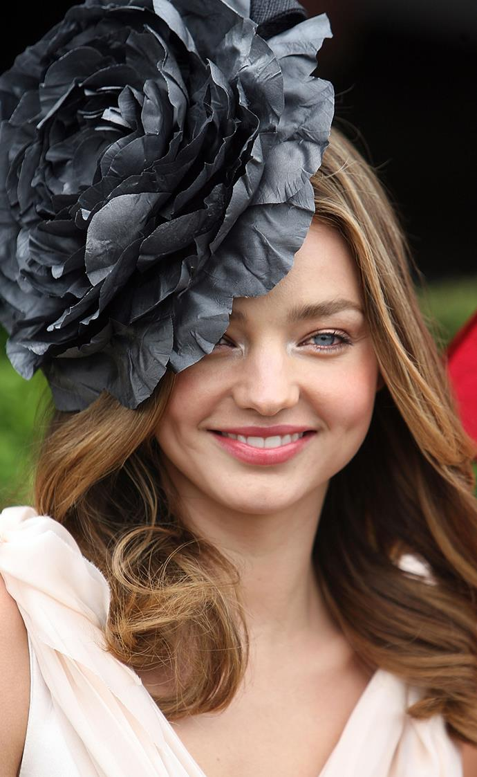 **Miranda Kerr at Melbourne Cup Day, 2009** <br><br> Leaving the rest of her face natural, Kerr's light-catching pastel eyeshadow and coral lip proved a winning formula. For a more subdued take on eyes, try the technique with a dark blue or grey palette.