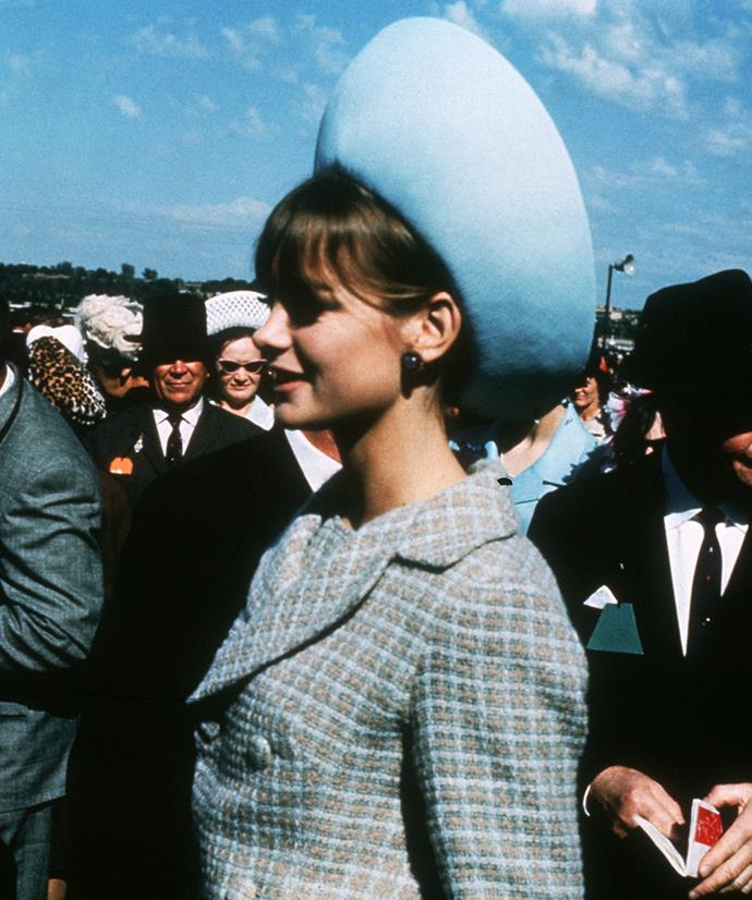 **Jean Shrimpton at Melbourne Cup Day, 1965** <br><br> It may have been her knee-skimming skirt suit that had heads turning at the time, but it's Jean Shrimpton's refined race-day beauty that holds a timeless charm. Copy the look by sweeping hair back (allow your statement earrings to sing) and coating lashes with a lengthening mascara. Defined eyebrows and a sheeny glossed lip will complete the look.