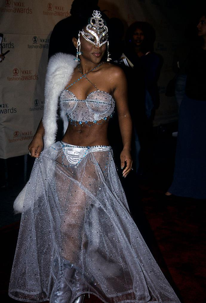"**Lil' Kim (1999)** <br><br> In 1999, the 'How Many Licks?' rapper wore this lingerie set and sheer skirt to present an award to her friend, the late [Alexander McQueen](https://www.harpersbazaar.com.au/fashion/kate-middleton-alexander-mcqueen-tiara-17537|target=""_blank""), at the VH1/*Vogue* Fashion Awards, seeing her transition from performer to fashion icon."