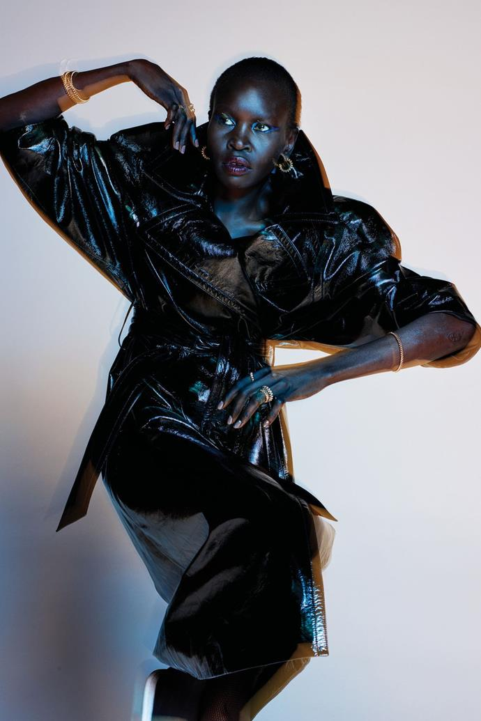**Alek Wek** <br><br> In a Balenciaga coat and Cartier earrings, bracelets, and rings.