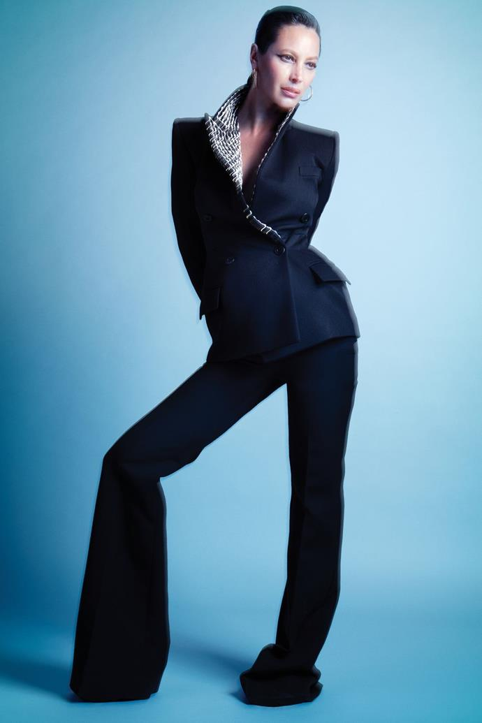 **Christy Turlington** <br><br> In a Givenchy jacket and trousers, and Cartier earrings.