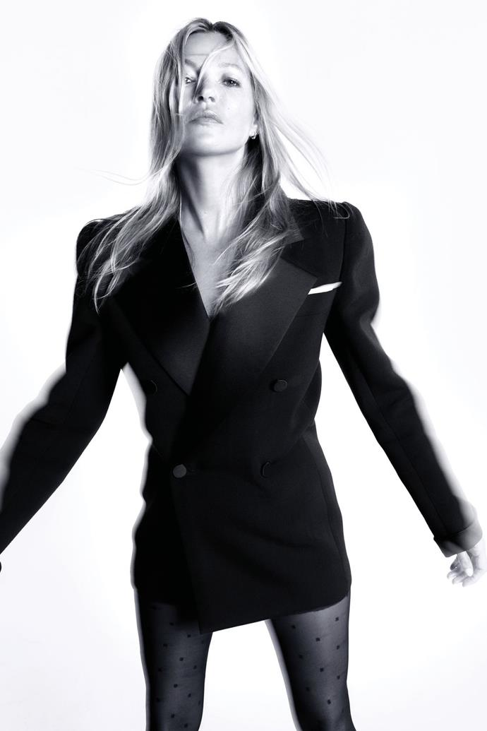 **Kate Moss** <br><br> In a Saint Laurent by Anthony Vaccarello tuxedo jacket and tights, and Moss's own earring.