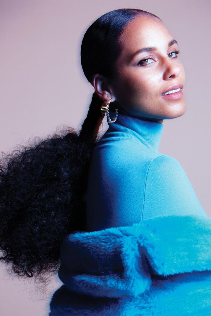 **Alicia Keys** <br><br> In a Max Mara coat and turtleneck, and Cartier earrings.