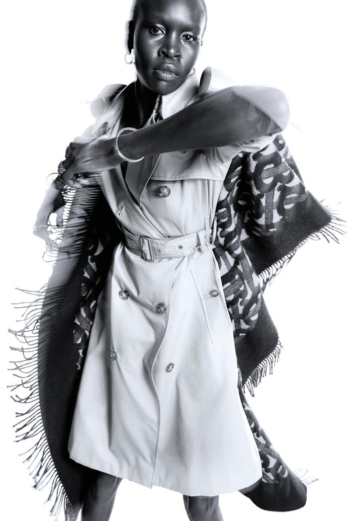**Alek Wek** <br><br> In a Burberry trench coat, and Cartier earrings, bracelets, and rings.