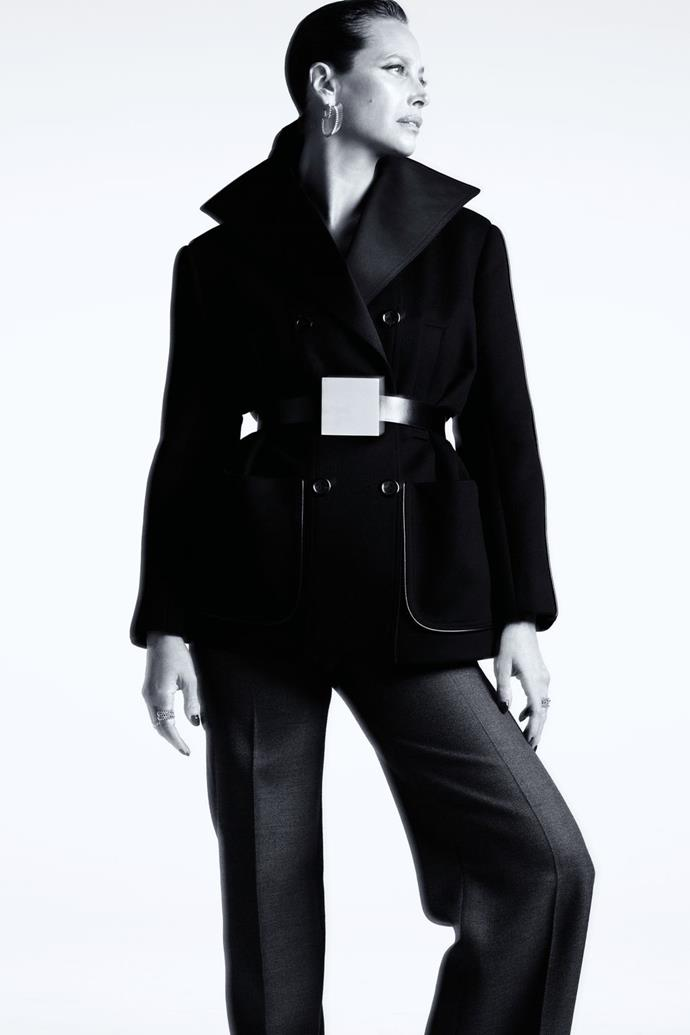 **Christy Turlington** <br><br> In a Louis Vuitton coat, pants, and belt, and Cartier earrings and rings.