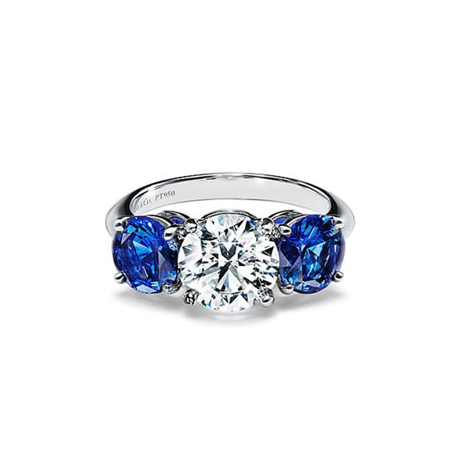 "Sapphire and platinum ring, POA by [Tiffany & Co.](https://www.tiffany.com.au/engagement/engagement-rings/tiffany-three-stone-engagement-ring-with-sapphire-side-stones-in-platinum-GRP10899/|target=""_blank""