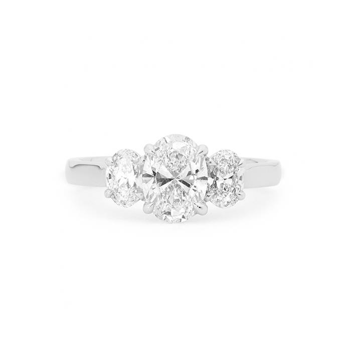 "Diamond and white gold ring, POA by [Matthew Ely.](https://www.matthewely.com.au/products/oval-cut-trilogy-diamond-ring/5471/?terms=43|target=""_blank""