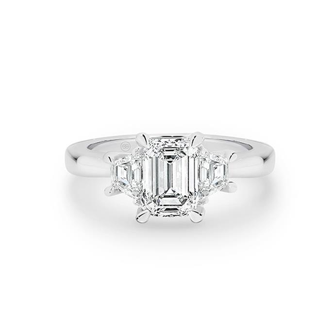 "Diamond and white gold ring, POA by [Gregory Jewellers](https://www.gregoryjewellers.com.au/jewellery/rings/engagement-rings/emerald-and-trapezoid-diamond-ring-with-soft-rounded-classic-band.html|target=""_blank""