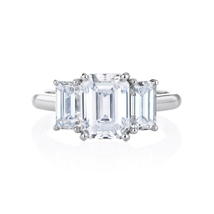 "Diamond and platinum ring, POA by [De Beers Jewellers](https://www.debeers.com/db-classic-trio-emerald-cut-solitaire-ring-j1ex06ep|target=""_blank""