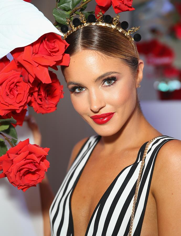 **Olivia Rogers at Colgate Optic White Stakes Day, 2018** <br><br> Rogers worked a smoky eye and statement red lip to elevate her monochrome ensemble and conservative choice of headpiece. Modern yet timeless.