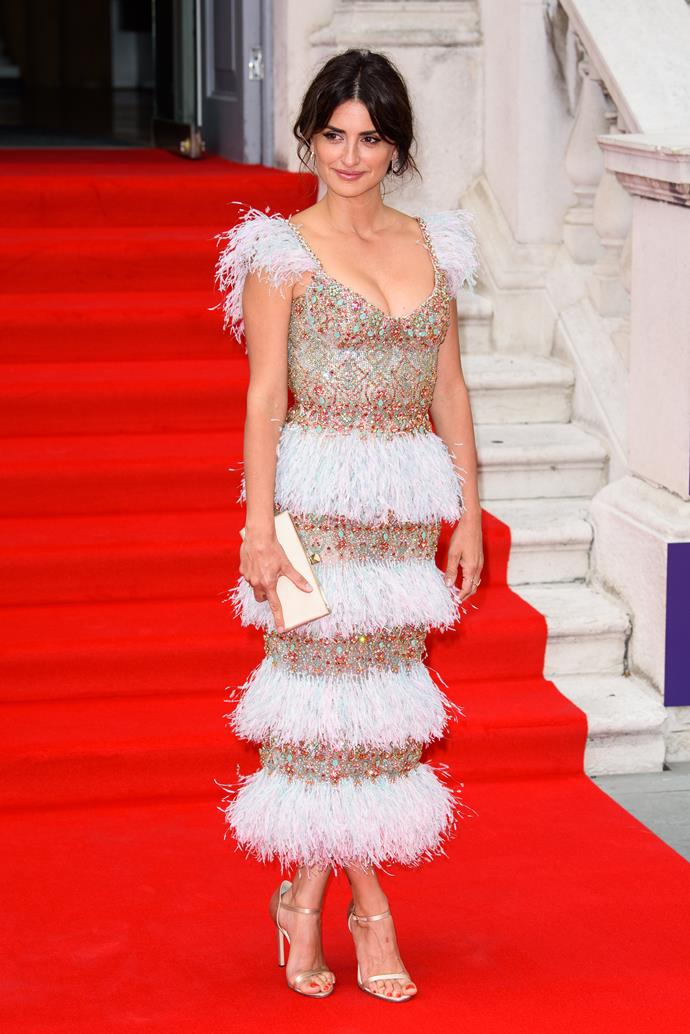 **Level 3:** Penélope Cruz wearing Ralph & Russo Haute couture to the London premiere of *Pain and Glory* in 2019<br><br>  Stunning in Ralph & Russo Haute Couture, Penélope Cruz's tiered sequin and feathers midi dress sits beautifully at level three.
