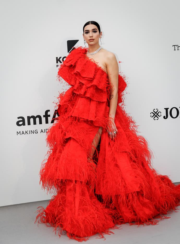 **Level 9:** Dua Lipa wearing Valentino Couture to the 2019 amfAR Gala<br><br>  Picking up where Elsa Hosk's hemline left off, Dua Lipa's vermilion Valentino gown with tiers of cascading feathers makes for an incredible level eight.