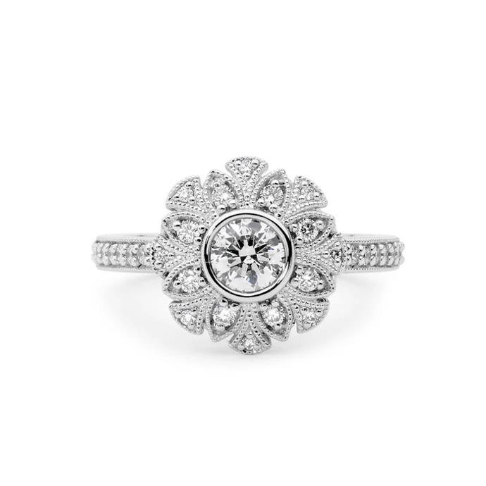 "Round-cut diamond with floral halo ring, $9,950 by [Linneys](https://www.linneys.com.au/collections/engagement/products/floral-diamond-ring|target=""_blank""