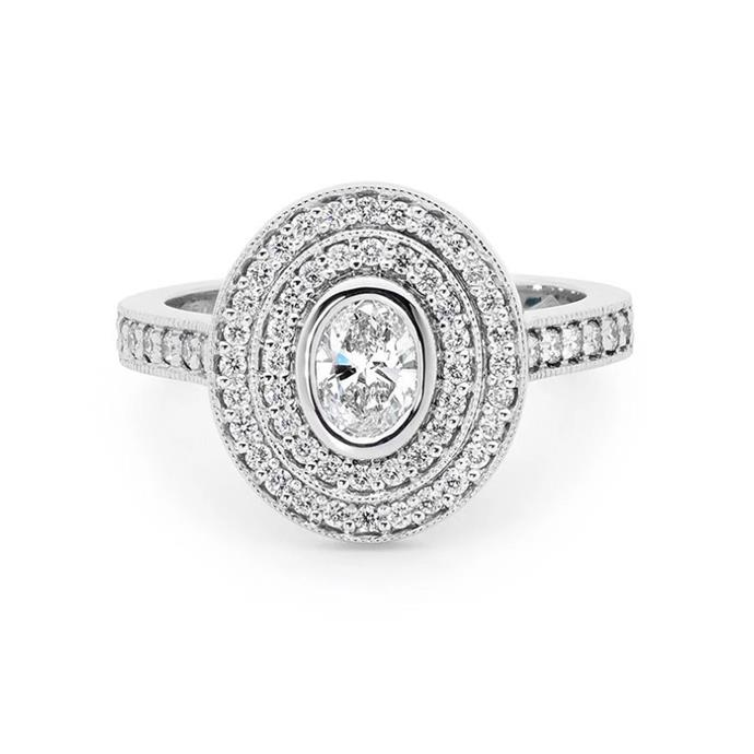 "Oval-cut ring with diamond double halo, $6,800 by [Linneys](https://www.linneys.com.au/collections/engagement/products/oval-cut-diamond-ring-2|target=""_blank""