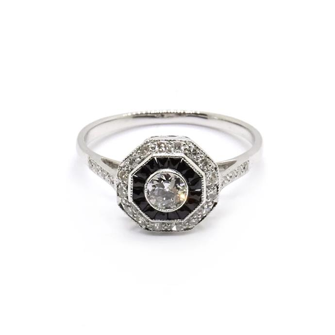 "Diamond and onyx halo ring, $4,000 by [Natalie Marie Jewellery](https://www.nataliemariejewellery.com/collections/engagement-rings/products/ada-vintage-diamond-and-onyx-art-deco-style-ring?variant=19828912095330|target=""_blank""