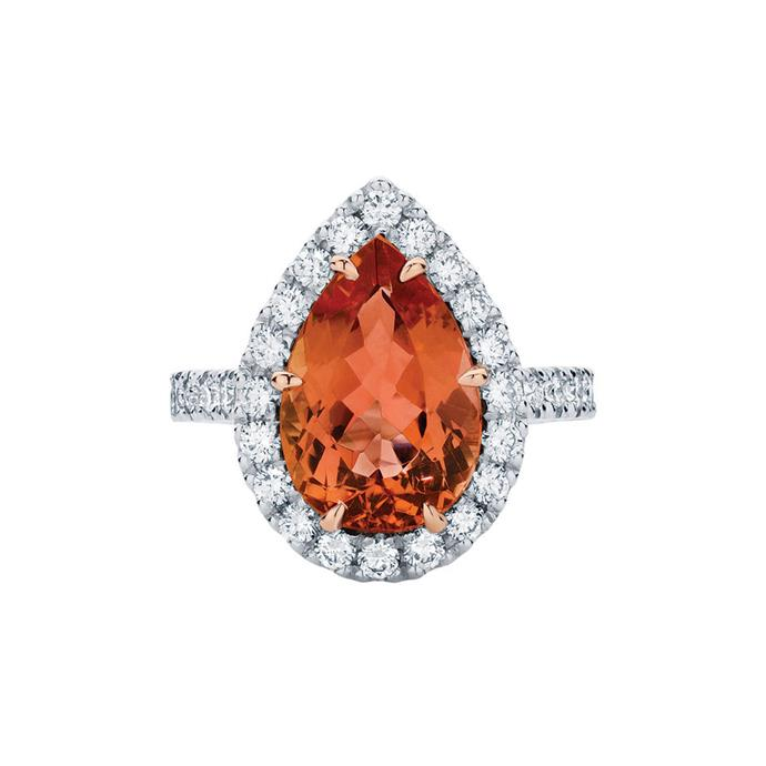 "Pear-cut topaz ring with diamond halo, POA by [Larsen Jewellers](https://www.larsenjewellery.com.au/engagement-rings/pear-cut/rosetta-pear-white-gold|target=""_blank""