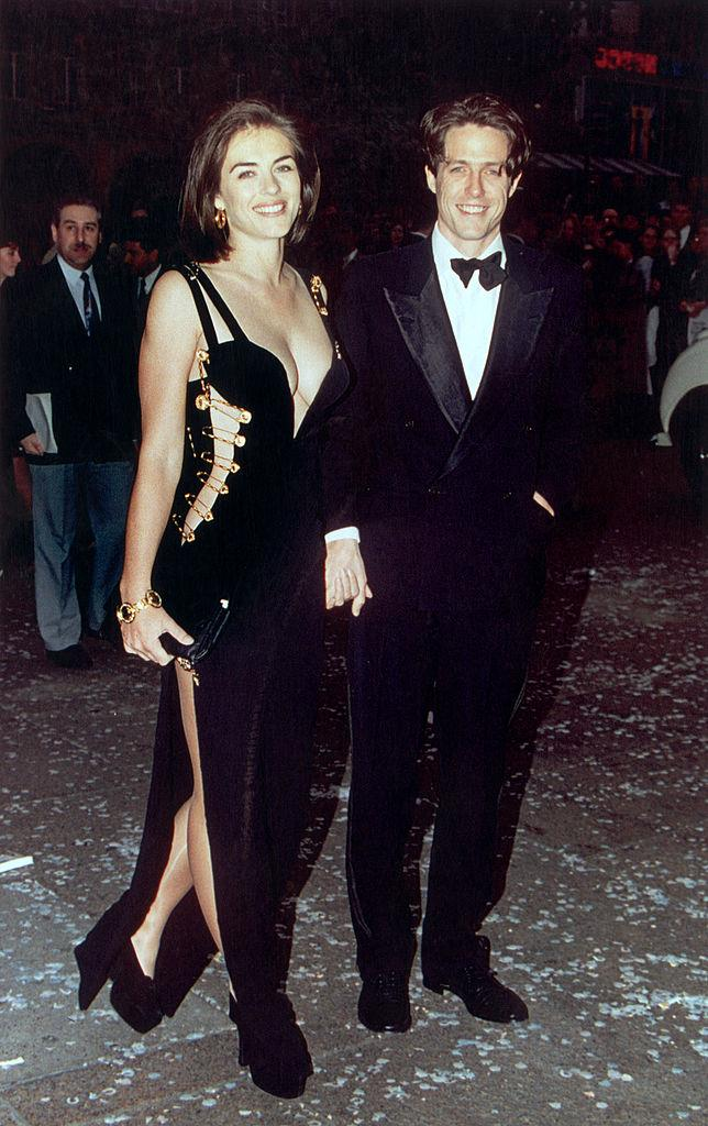 "**Elizabeth Hurley wearing Versace to the premiere of** ***Four Weddings and a Funeral*** **in 1994**<br><br>  A true fashion 'moment' if we ever saw one, Elizabeth Hurley's risqué safety-pin dress (which was simply known at the time as ""THAT dress"") propelled Versace to new heights. Moreover, the media frenzy that followed bolstered the maison's reputation for designs that, [according to](https://edition.cnn.com/style/article/liz-hurley-versace-remember-when/index.html