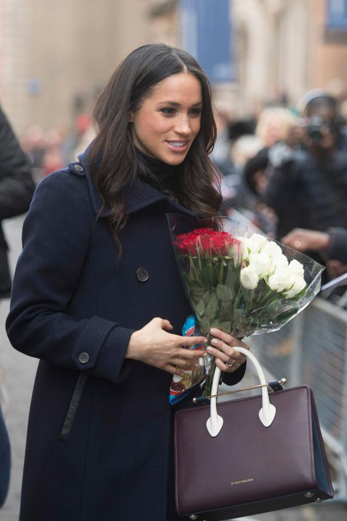 "**Meghan Markle carrying a bag by Strathberry at her first royal engagement in 2017**<br><br>  Although it's technically not a red carpet moment, it was Meghan Markle's first royal engagement, and it certainly turned gave a relatively unknown brand international recognition. The brand in question? Scottish handbag label Strathberry, with Markle's burgundy purse [selling out](https://www.harpersbazaar.com/uk/fashion/fashion-news/a14004448/meghan-markle-strathberry-handbag-sells-out/|target=""_blank""