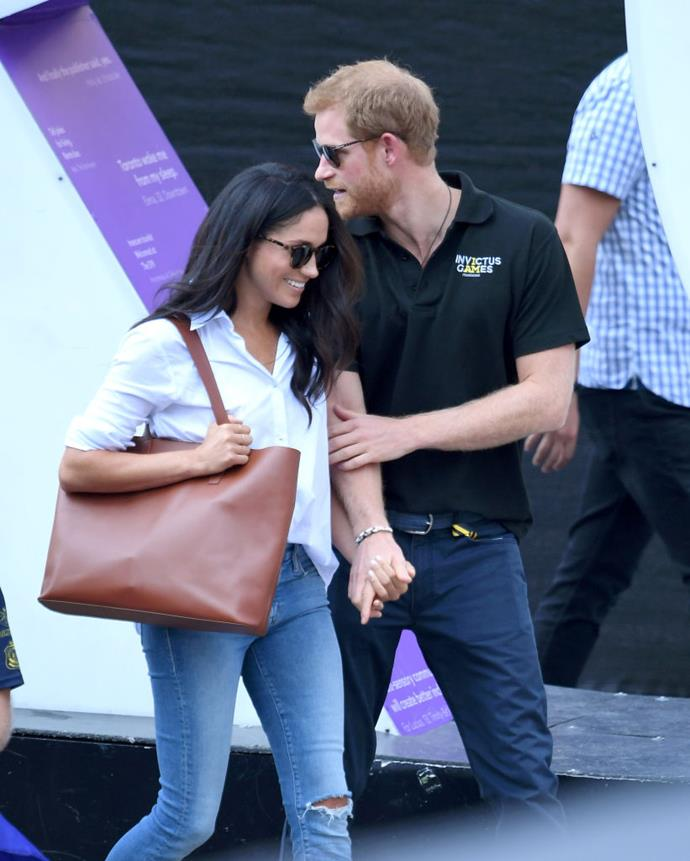 **1. The chic off-duty look** <br><br> Meghan made her first public appearance with Prince Harry at the Invictus Games in Canada in September 2017, where she wore a streamlined white button-up shirt and frayed jeans. The soon-to-be Duchess also sported a tan leather bag, making the ultimate smart-casual colour scheme, and wore her white shirt slightly untucked.