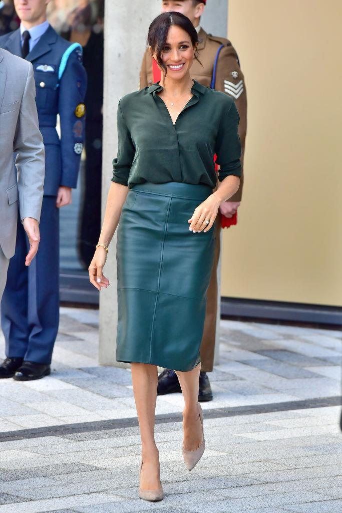 """**3. The smart casual workwear look** <br><br> In October 2018, prior to announcing her pregnancy, Meghan stepped out in a deep green button-up shirt by label [& Other Stories](https://www.stories.com/en_gbp/about/about-us.html