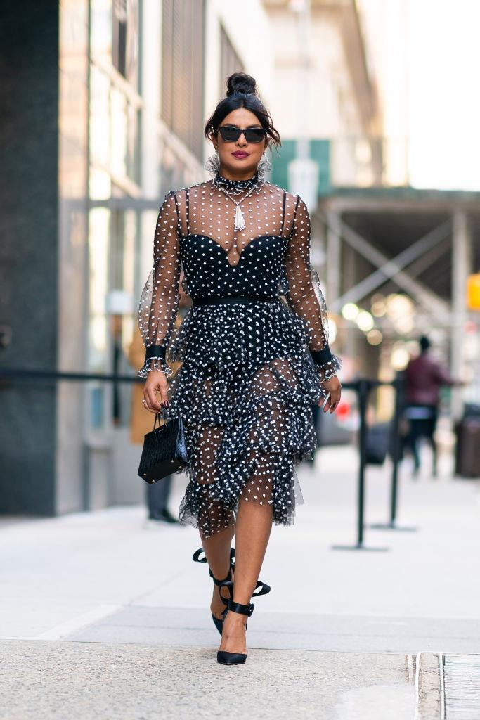"Priyanka Chopra carrying the Medea ""Short Croc"" bag in Black, approximately $938, from [Medea](http://medeamedea.it/products/short/croc-print/short-croc-black