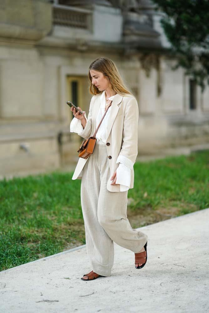 Relaxed suiting with tan accessories.