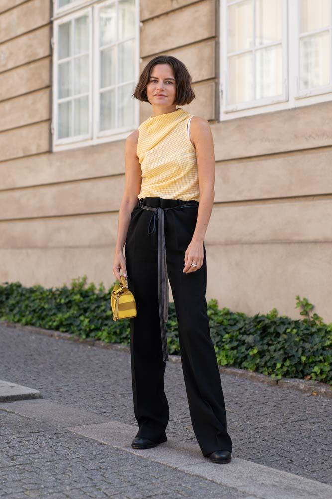 A punchy sleeveless top and well-cut trousers.