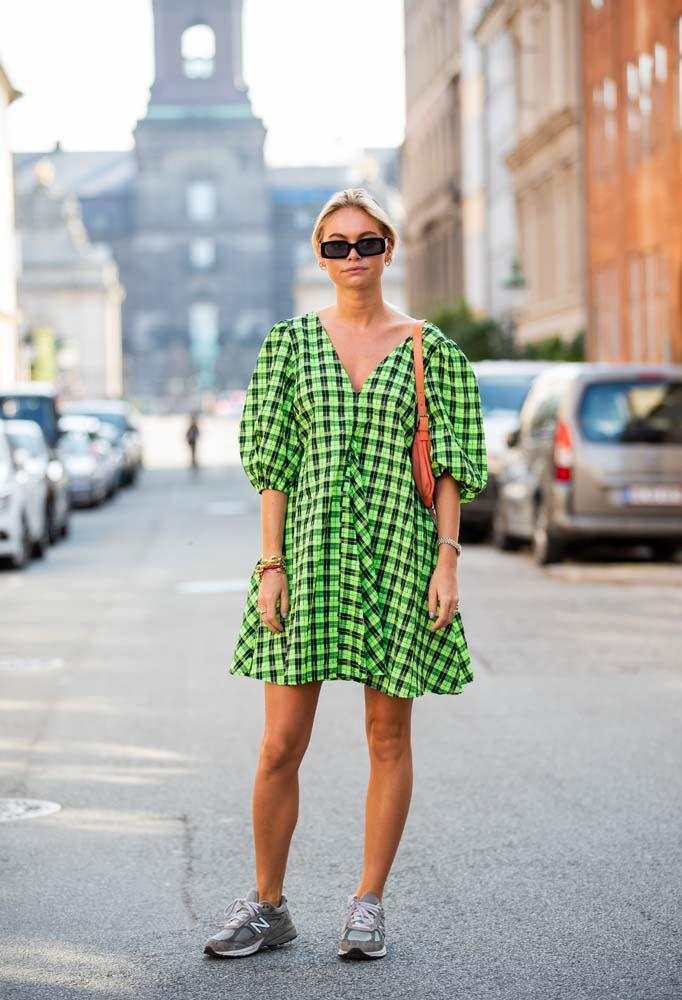 A neon-bright dress and sneakers.
