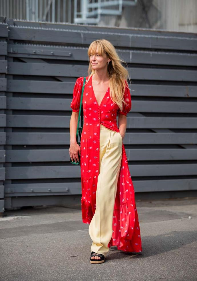 A maxi dress worn open over trousers.