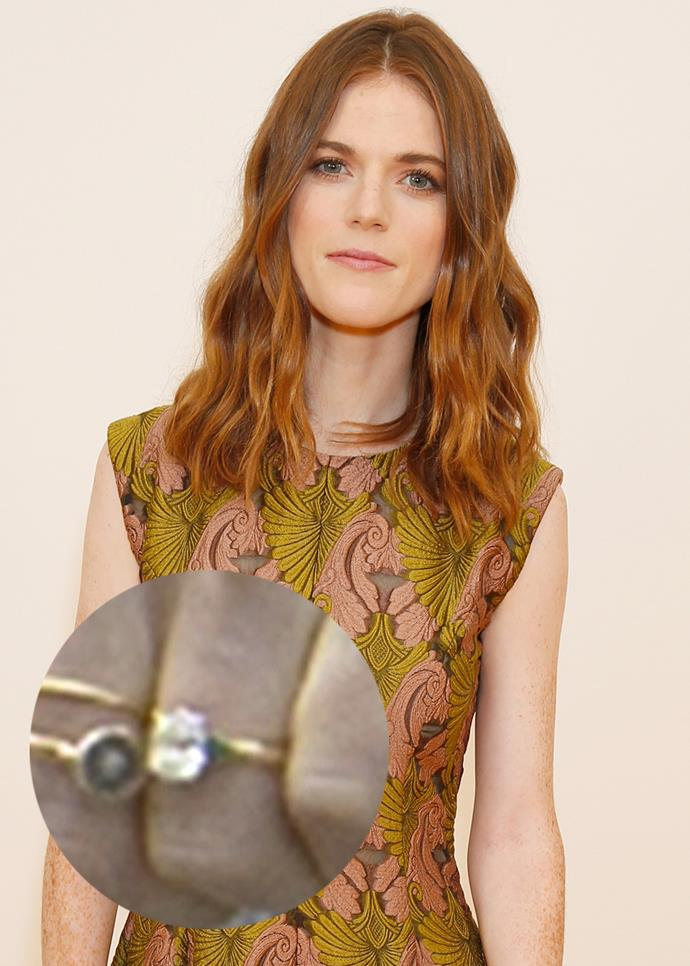 ***Rose Leslie***<br><br> Rose Leslie's ring from *Game of Thrones* star Kit Harington features a delicate oval-cut diamond on a plain gold band.