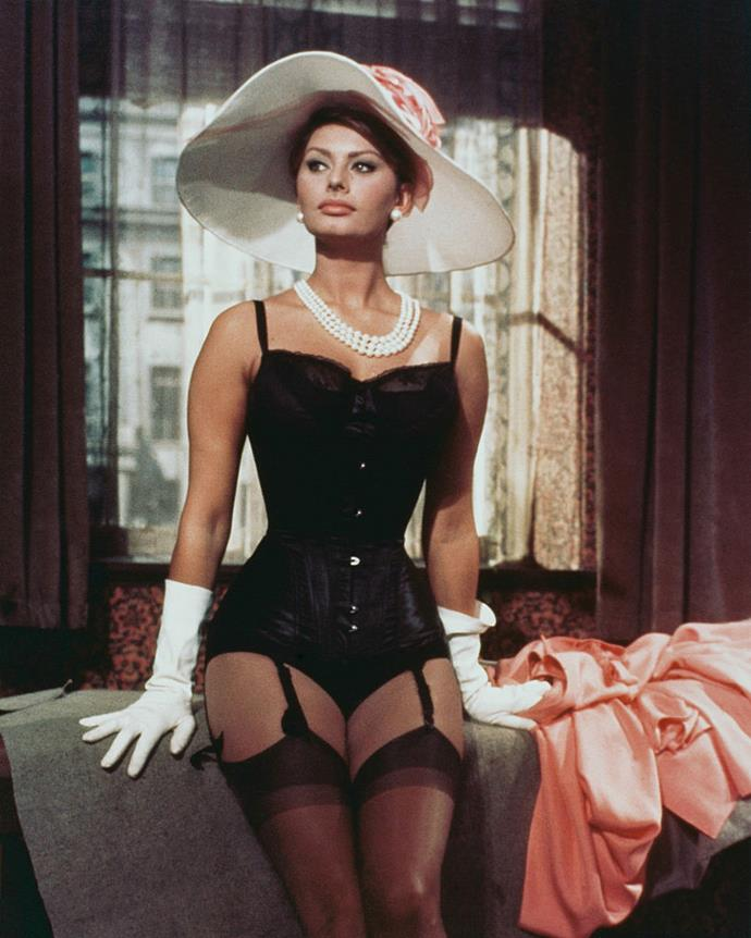 Sophia Loren in a black corset with suspenders and stockings in *The Millionairess* in 1960.