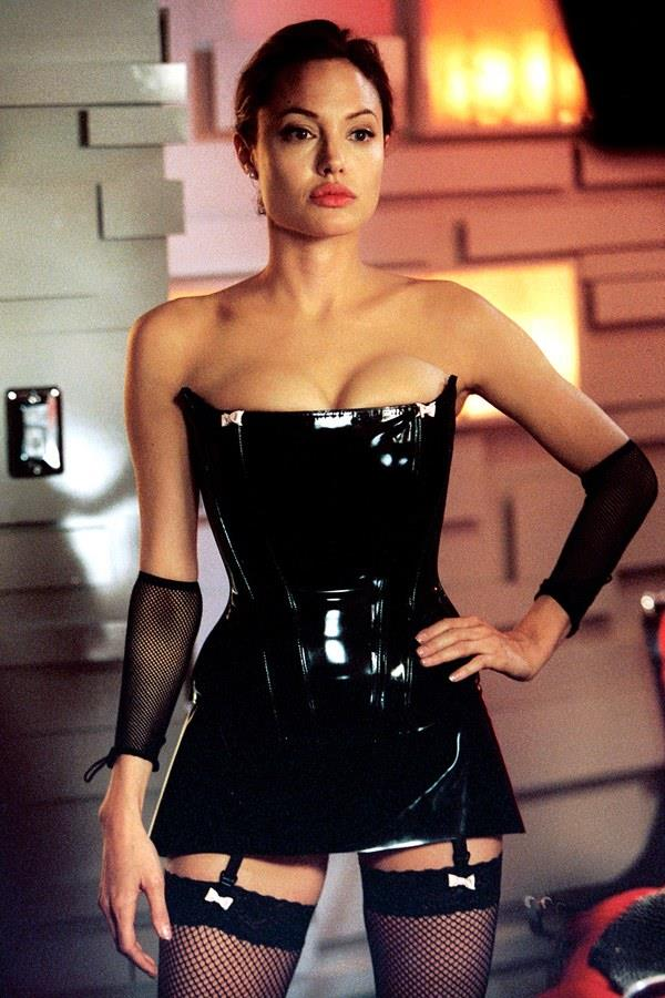 Angelina Jolie in a strapless leather corset in *Mr. & Mrs. Smith* in 2005.<br><br>  *Image via IMDb*