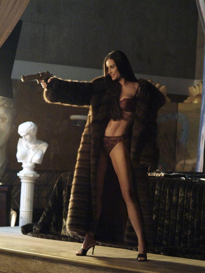 Demi Moore in burgundy lingerie and a floor-length fur coat in *Charlies Angels: Full Throttle* in 2003.