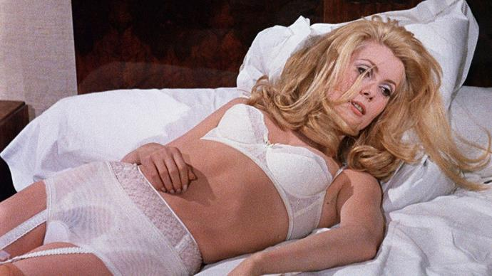 Catherine Deneuve in a matching white set with sheer accents in *Belle de Jour* in 1967.