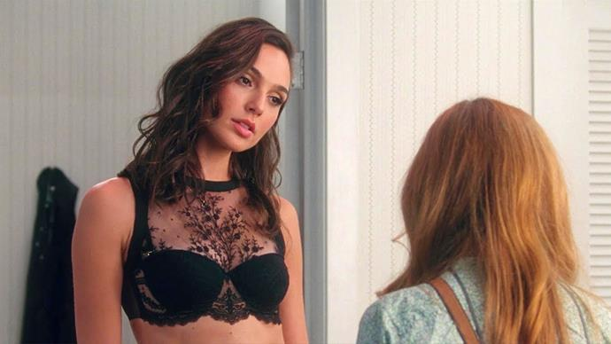 Gal Gadot in a high-necked lace bra in *Keeping Up With The Joneses* in 2016.