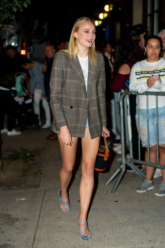 Sophie Turner wearing a relaxed check blazer in 2019.