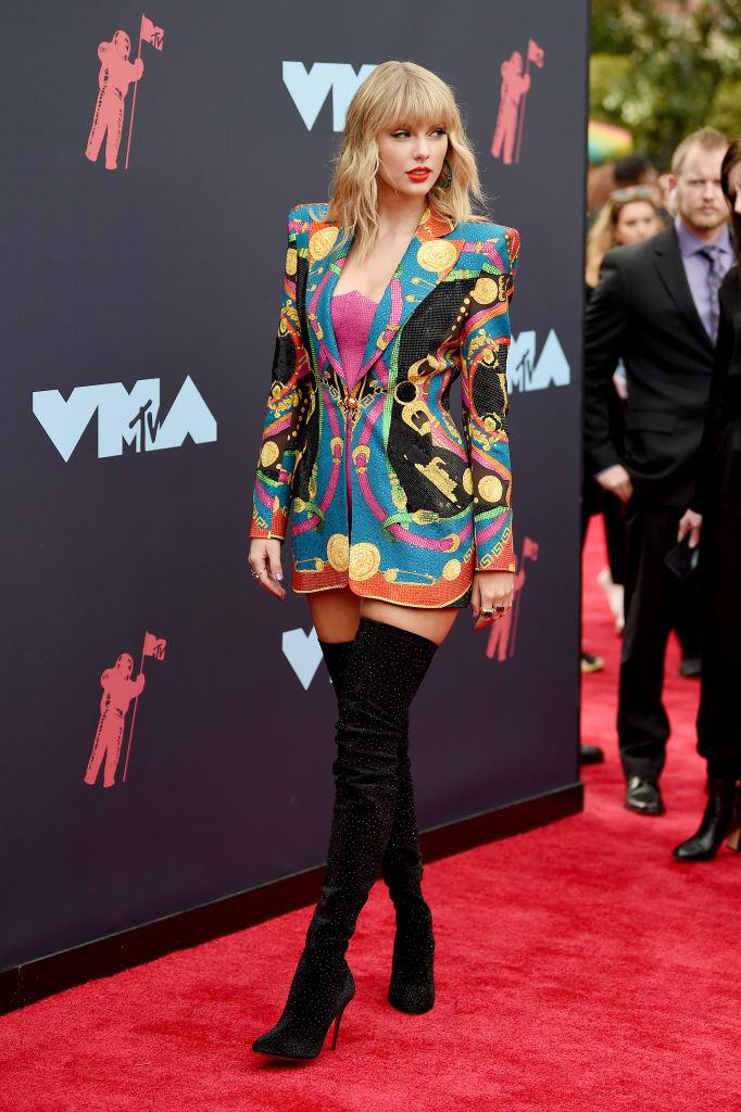 Taylor Swift wearing a bold printed drazer in 2019.