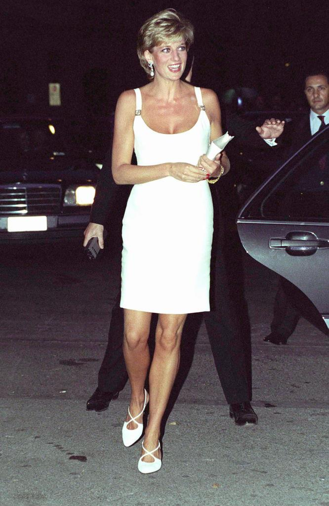 **Princess Diana in Versace (1995)** <br><br> In the mid-'90s, Diana further asserted her independence by wearing more revealing gowns than she would have been allowed to wear as a royal. Here, she's pictured in 1995 wearing a white mini-dress by Gianni Versace, whose designs were considered daring at the time. <br><br> *Image: Getty*