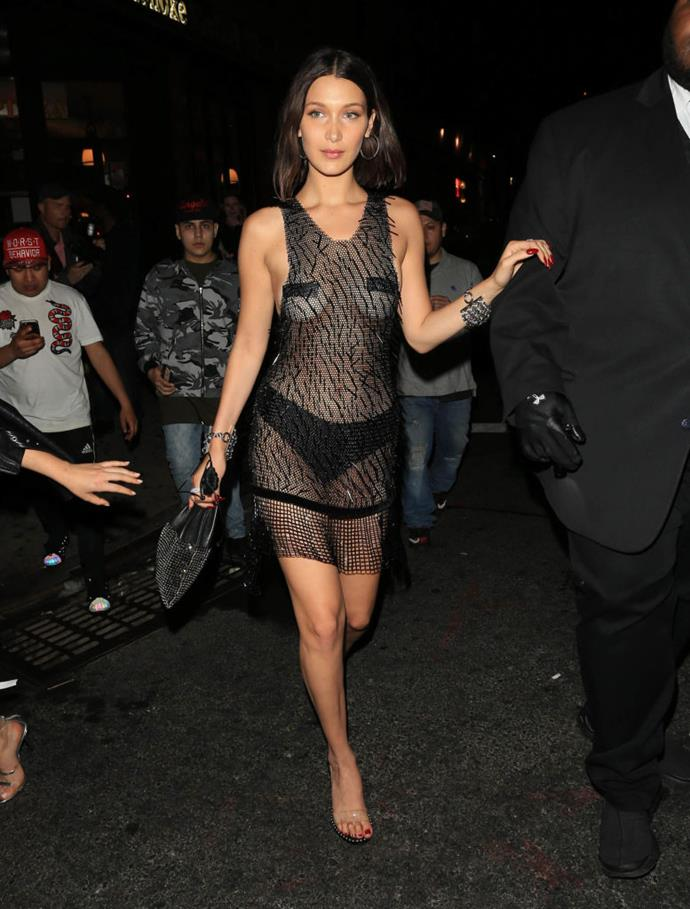 **Bella Hadid in Alexander Wang (2017)** <br><br> While many thought Hadid couldn't go much racier than her Met Gala look, she proved that she could go much bolder (on the same night, no less). The supermodel continued her risqué streak with this entirely sheer black look, with only tape and underwear preventing complete nudity. <br><br> *Image: Getty*