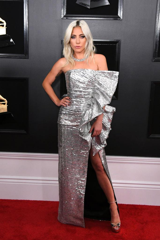 **Lady Gaga in Celine (2019)** <br><br> In February 2019, news surfaced of Lady Gaga's split from her fiancé, Christian Carino, around the time that tabloids incorrectly speculated a romance was brewing between the performer and her *A Star Is Born* co-star, Bradley Cooper. <br><br> Only days after news of her split from Carino surfaced, Gaga attended the 2019 Grammy Awards in an edgy Celine by Hedi Slimane gown—a notable departure from the more conservative looks she donned during the 2019 awards season. <br><br> *Image: Getty*