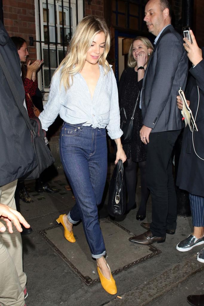 In double-denim with statement footwear.