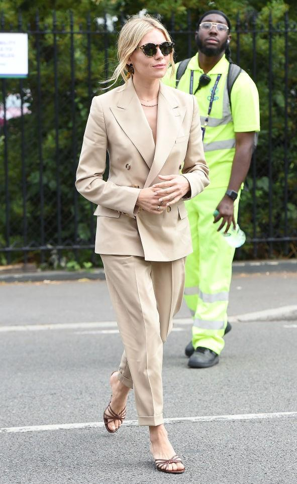 In a beige suit at Wimbledon.
