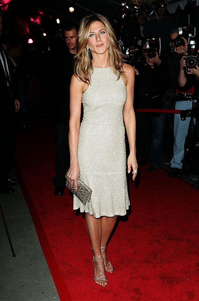 **Jennifer Aniston in Chanel (2005)** <br><br> Aniston was subjected to one of the prickliest splits in Hollywood history, when she and her then-husband Brad Pitt broke up, only for him to couple with his *Mr. & Mrs. Smith* co-star, Angelina Jolie, soon after. <br><br> However, following news of the breakup, Aniston had the perfect revenge moment when she wore this effortless Chanel dress to a red carpet event in October 2005. <br><br> *Image: Getty*