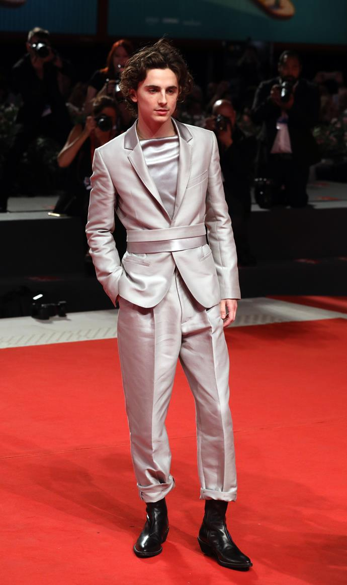 "**Timothèe Chalamet in Haider Ackerman** <br><br> ""If we needed any further proof that Timothee is in a league of his own when it comes to red carpet dressing (for both men and women, in my opinion), this futuristic silver belted suit is it. The blouse, the nonchalantly rolled cuffs, the boots—oh my, oh my."" <br> —*Mahalia Chang, Digital Managing Editor*"