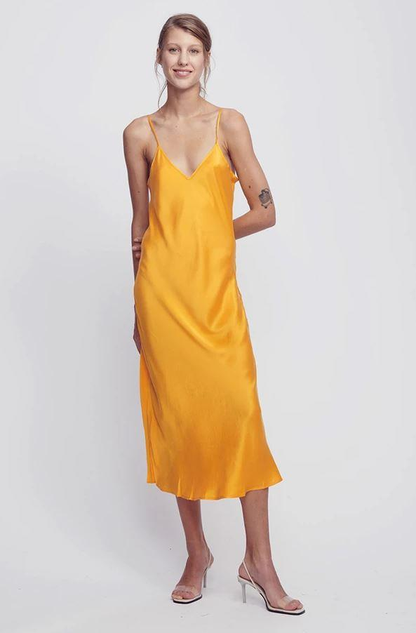 """***The colourful slip dress***<br><br>  '90s Slip Dress' by Silk Laundry, $250 from [Silk Laundry](https://silklaundry.com.au/collections/dresses-1/products/copy-of-90s-silk-slip-dress-iconic-marigold